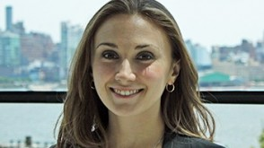 Headshot of Genevieve Finn with New York City in the background.