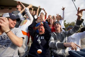 fans cheering at an athletic event at DeBaun field