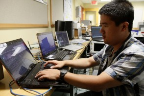 Student working on laptops in lab