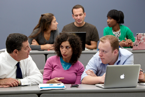Photo of two separate groups of students collaborating.