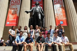 A group of pre-college students outside Federal Hall in New York City.