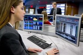 A female student works on a terminal in the analytics and visualization lab.