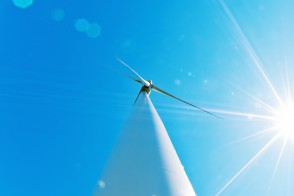 A wind turbine viewed from directly underneath