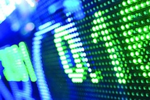 Financial data, in green numbers, on a blue computer screen.
