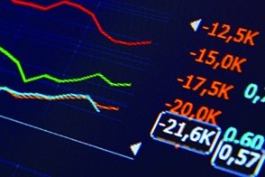 Line graphs showing market data on a blue screen.