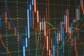 Colorful financial charts on a black screen.