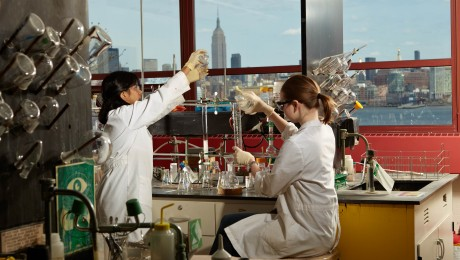 students working in a lab with the Empire State Building in the background