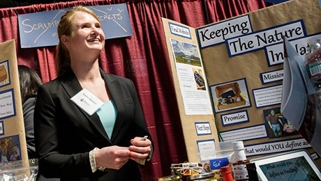 Jessica Spanier surrounded by Vermont foods and gifts at the InnovatioN Expo.