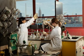 Two student performing lab research