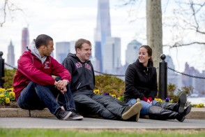 Students sitting on the campus lawn at Stevens Institute of Technology
