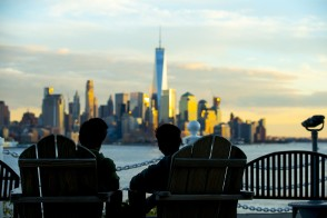 Couple sitting and looking at city skyline