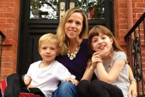Professor and children sitting on the stoop of their Hoboken home