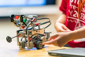 Student displaying finished robot.