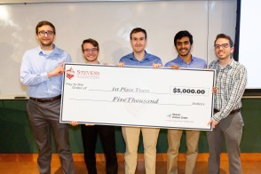 Winners of the 2019 HealthTech Hackathon pose with a ceremonial check