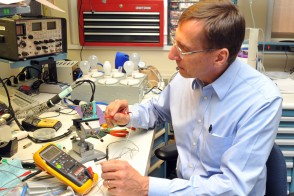 Photo of Dr. Herman Morchel working in the biomedical equipment lab at Hackensack University Medical Center