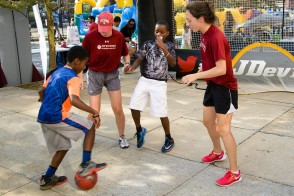 Stevens student-athletes playing soccer with local youth