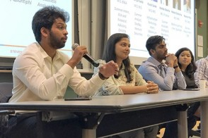 A panel of graduate students answers questions during a Q&A.