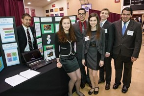 A team of six students presenting its findings in healthcare at the Innovation Expo.