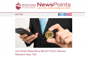 A person holding a bitcoin while using a smartphone