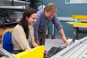 A photo of a student and an advisor working together