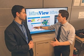 Two students explain their business concept in a workshop space at the Stevens Venture Center.