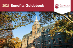 Cover of Benefits guidebook with large building