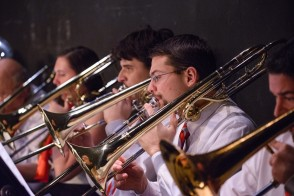 students in the Stevens orchestra playing brass instruments
