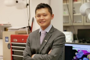 Portrait of professor Ke Du Ph.D. '15 in his laboratory at Rochester Institute of Technology