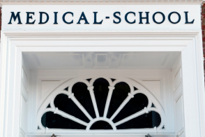Photo of a building labeled Medical School