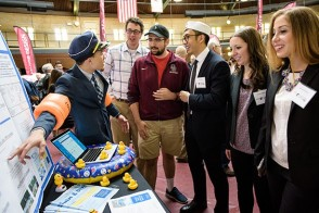 Students at 2017 Expo review senior design project.