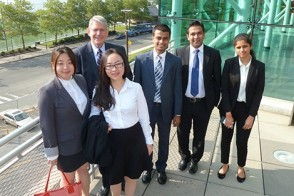 A team of MBA students meets before presenting the findings of their consulting work to Pershing executives.
