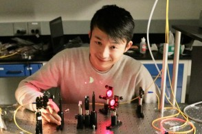 A student with a laser
