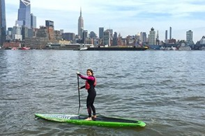 A student paddles on the Hudson River.