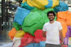 Portrait of entrepreneur and data scientist Raphael Presberg M.S. '18 in front of a colorful sculpture