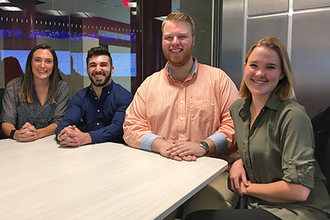 Four students collaborate in the high-tech Hanlon Lab.