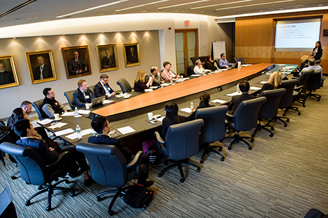 Students and faculty, and Wiley managers, in the company's boardroom.