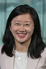 Headshot of Dr. Ying Wu with New York City in the background.
