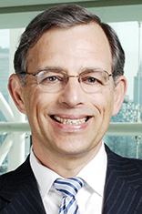 Headshot of Dr. Zvi Aronson with the New York skyline in the background.